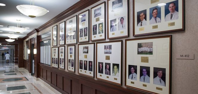 Hall of framed photos of WCM alumi.